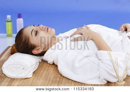 beautiful asian woman relaxing in spa salon