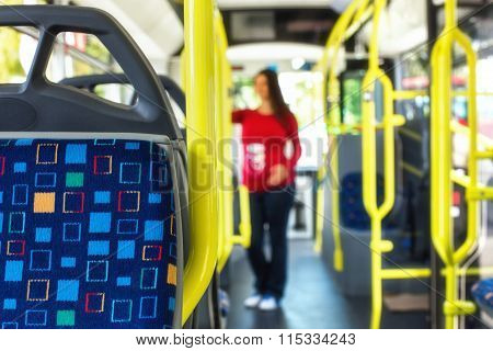 Pregnant Woman Travelling With Public Autobus Or Tramway, During Her Commute To Work/school
