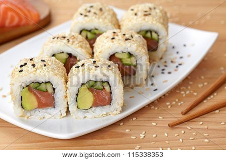 California roll sushi traditional Japanese rice food with salmon, avocado, cucumber, nori and sesame