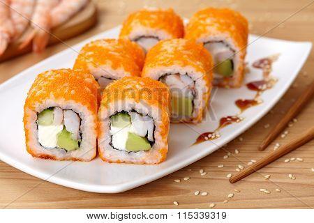 Philadelphia sushi roll with shrimp, avocado, cream cheese, cucumber and tobiko caviar.