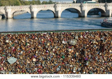 PARIS FRANCE - OCTOBER 9 2014: Paris France - Pont des Arts. Love padlocks on the bridge. Passerelle des Arts is a pedestrian bridge in Paris which crosses the River Seine