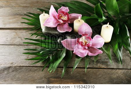 Spa still life with beautiful flower and candlelight on wooden table, top  view