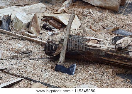 Axe near a log.