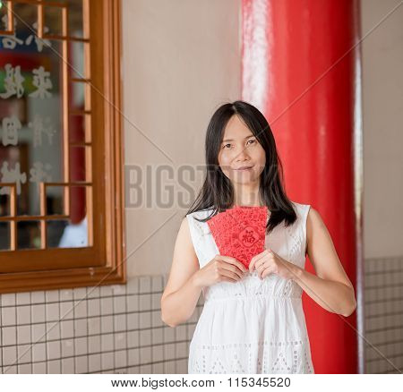 Asian Lady Holding Red Envelope Or Ang-pow .