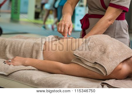 Beautiful Young Woman Having Massage On Abdomen In A Spa