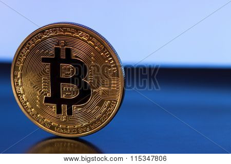 Bitcoin Symbol On Blue Background