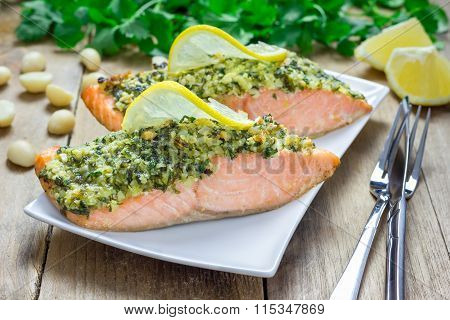 Baked Salmon With Macadamia-cilantro Crust On A White Plate