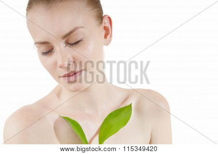 Beautiful Woman With A Healthy And Well-groomed Complexion Holding Green Leaf . Spy Beauty Skin Trea