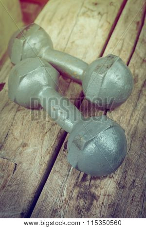 Metal Iron Dumbbell On Wood Sport Of Fitness Bodybuilding Background