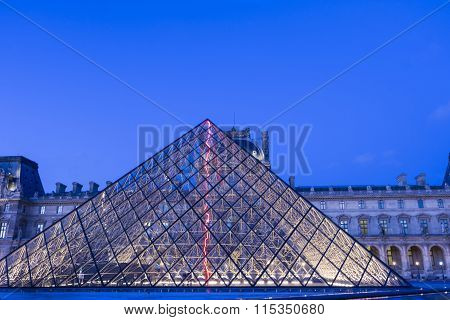 The Louvre Pyramide In Evening, Paris, France.