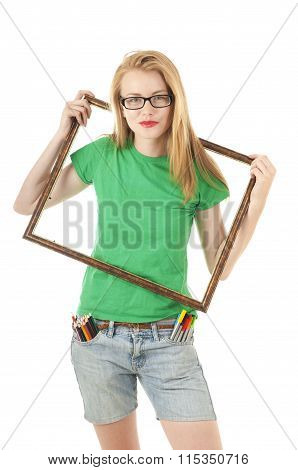 Creative Girl  With Colored Pencils, Felt-tip In Pocket And Holds Empty Frame From Picture.