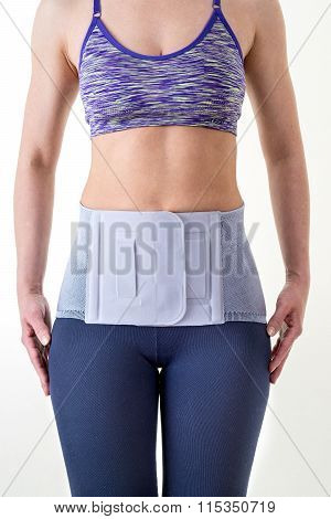Athletic Woman Wearing Lower Back Support Brace