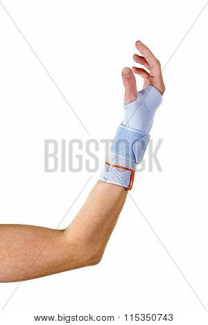 Man With Bent Elbow Wearing Wrist Brace In Studio