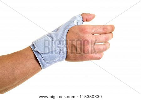 Man Wearing Supportive Brace On Wrist And Hand