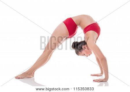 Rhythmic gymnast posing with her eyes closed