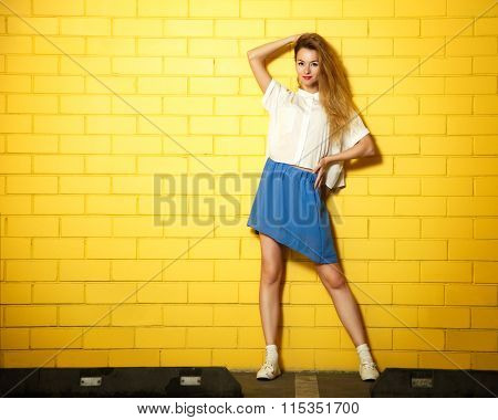 Street Style Hipster Fashion Girl at Yellow Wall
