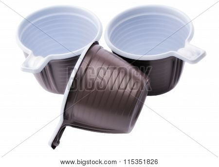 Three brown plastic disposable cups on a white background