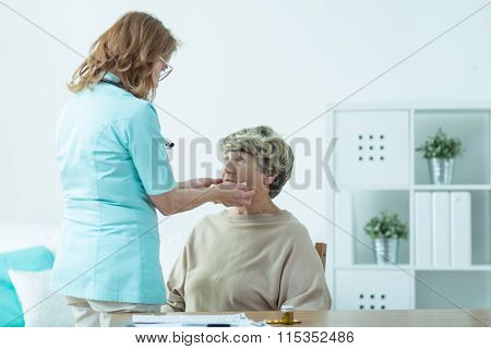 Senior Lady Examined By Doctor