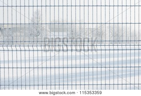 Winter background, landscape throught the gates. Winter scene. Christmas, New Year background