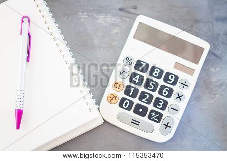 Calculator, Notepad And Pen On Grey Background