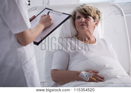 Elder Woman Talking To Doctor