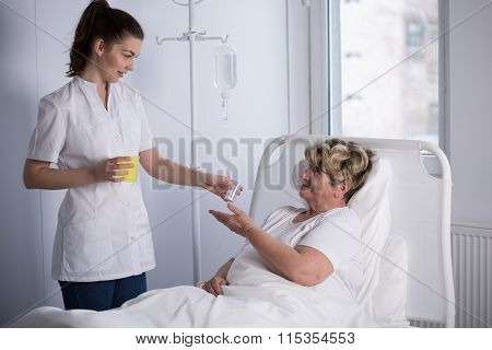 Nurse Giving Medicine To Patient