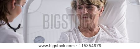 Elderly Lady Examined By Doctor