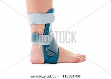 Man Wearing Ankle Support Brace In White Studio