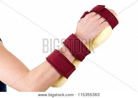 Person Wearing Cushioned Brace On Hand And Wrist