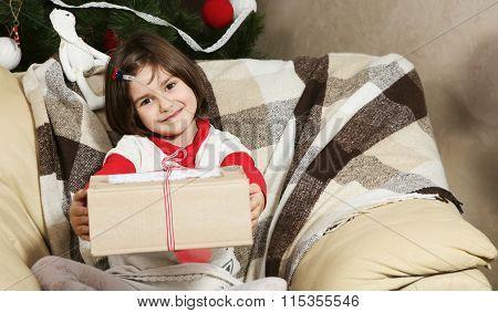 Little Girl With Christmas Gift