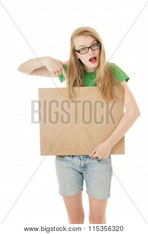 Happy Young Girl Holds Up  Empty Wooden Notice Board