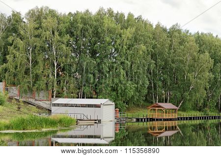 Wood And Metal Shed On The Pond