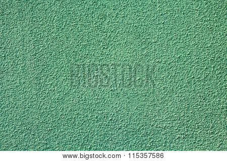 Green Stucco Relief On The Wall Of The House. Backgrounds And Textures