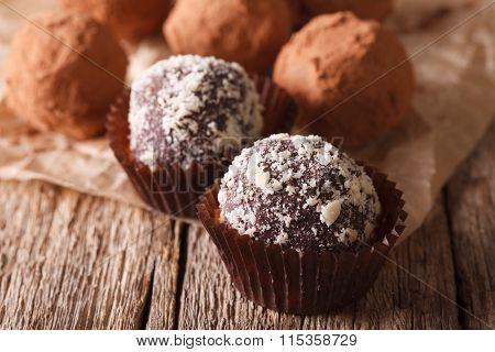 Chocolate Truffles Sprinkled With Nuts Macro. Horizontal