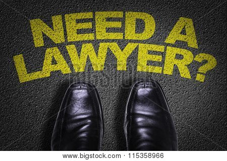 Top View of Business Shoes on the floor with the text: Need a Lawyer?