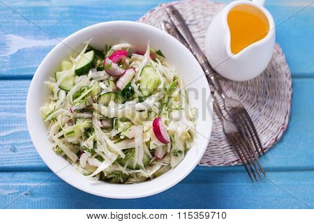 Salad From Cabbage, Herbs, Cucumber, Onion And Radish In Bowl
