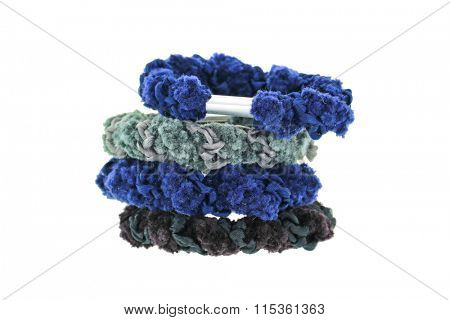 A stack of elastic head dressing, hair ties in blue and black shade isolated on white