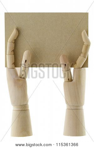 Wooden hands holding a piece of blank brown paper with copyspace