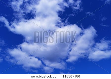 White Clouds On Blue Sky Background