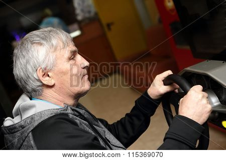 Man Playing With Car Simulator