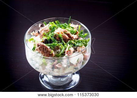 Vegetable Salad With Canned Tuna Is In The Glass.