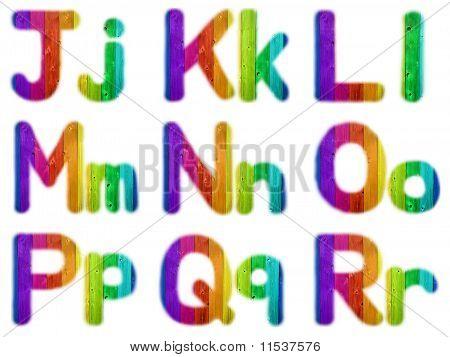Letters J K L M N O P Q R With A Wooden Rainbow Background