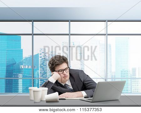 Young Man Sleeping At Working Place