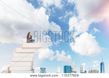 Woman On A Pile Of Book