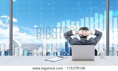 A Businessman Relaxing In His Office