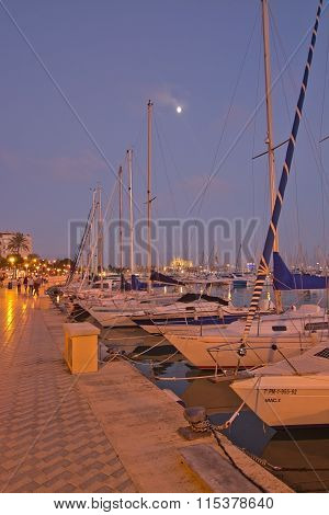 Moored Yachts And Nearly Full Moon Over The Cathedral