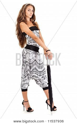 Young Pretty Lady In Harem Pants Posing With Black Umbrella On White