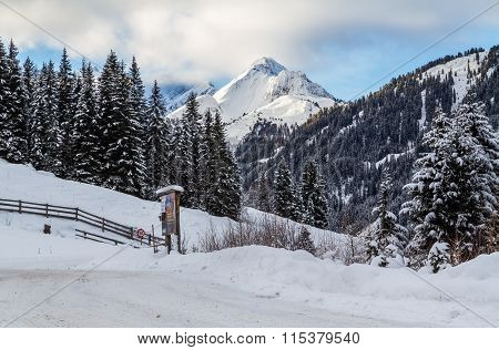 Snowbound road in Austria mountains.