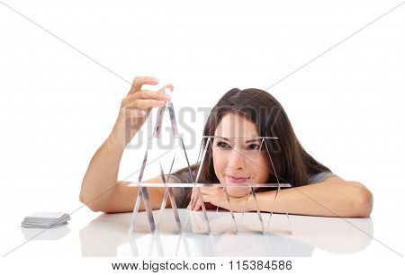 Young Woman with A House Of Cards