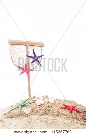 Beach with sand, fishing net and shells isolated over white background